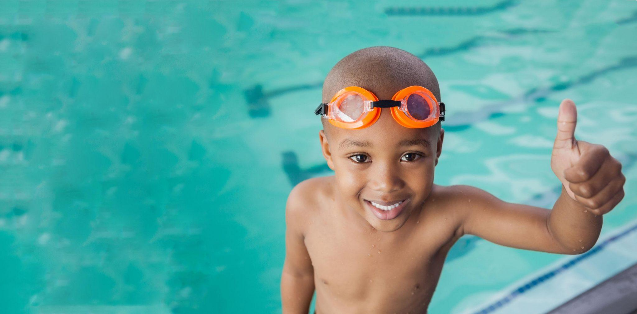 young male swimmer in goggles